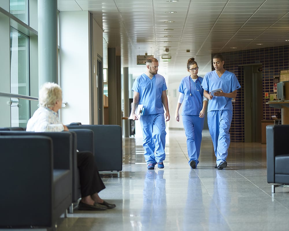 healthcare setting with nurses and doctors